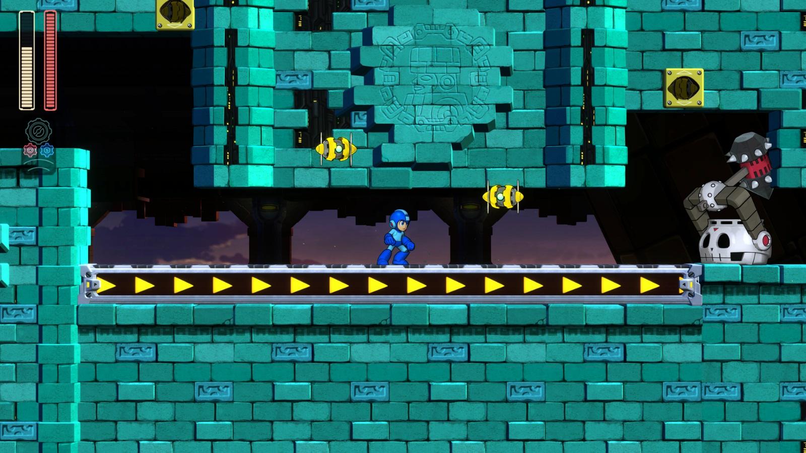 Mega Man 11 fase do Block Man esteira com inimigos